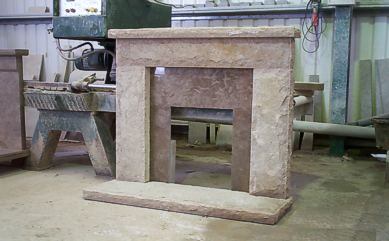 "Natural face Purbeck Fireplace with polished ""Cap"" insert"